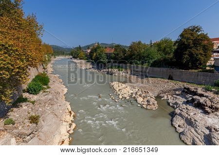 View of the Rioni River in Kutaisi on a sunny afternoon. Georgia.