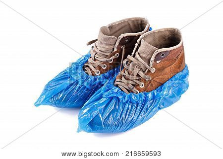 blue protective shoe covers on men's shoes isolated on white background