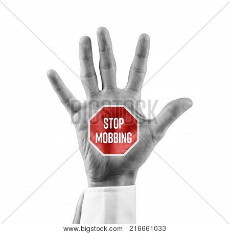 Stop mobbing concept. Businessman or human resources officer with open hand with stop street sign and text Stop Mobbing.