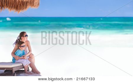 Panoramic photo of mother and son at tropical beach in Tulum Mexico
