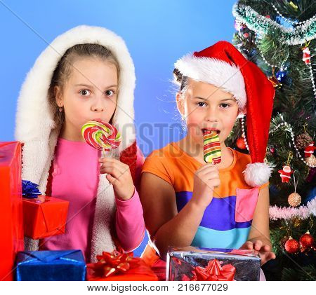 Childhood And Leisure Concept. Sisters In Christmas Hats