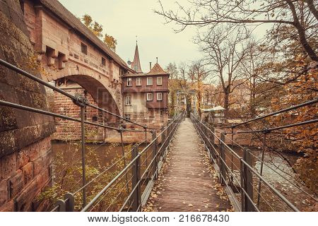 NUREMBERG, GERMANY - NOVEMBER 15, 2017: Old bridge across the river in the historic city with historical walls on November 15, 2017. Nurnberg is second-largest city in Bavaria popul. 763854.