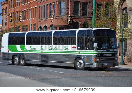 SYRACUSE, NY, USA - APR. 29, 2012: Birnie Coach Bus in downtown Syracuse, New York State, USA. Birnie Bus served lines in central New York area.