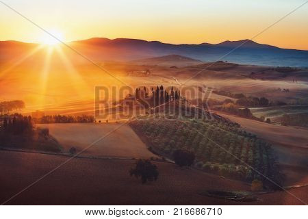 Tuscany, Panoramic Landscape With Famous Farmhouse Rolling Hills And Valleys In Beautiful Golden Mor