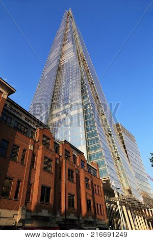 LONDON, GREAT BRITAIN - MAY 16, 2014: Skyscraper Shard is a new architectural dominant of the British capital with a height of 309 meters.