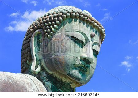 Daibutsu, Kamakura, Japan. The great bronze Buddha dates from around 1252 and is over 43 feet tall. The statue used to be housed in a temple but after the structure was destroyed several times, the Buddhist Priests left it uncovered.