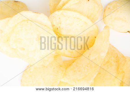 Crispy Thinly Sliced Potato Chips Closeup, On White Background.