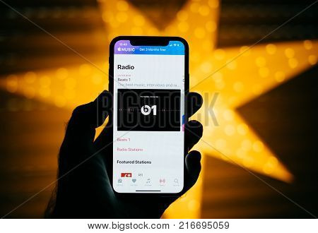 Paris France - Nov 10 2017: Man Holding The New Apple Iphone X 10 Display With Yellow Star Bokeh Bac