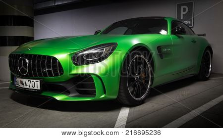 Zilina Slovak Republik / Slovakia - November 09 2017: Native green colour Mercedes-AMG GT R Coupe standing at underground parking in Zilina Slovakia