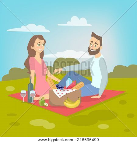 Couple at picnic. Couple sitting in park on blanket with food in the park.