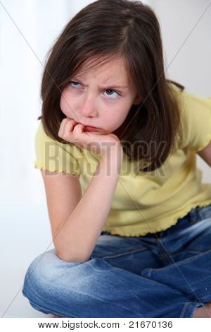 Portrait of grouchy little girl