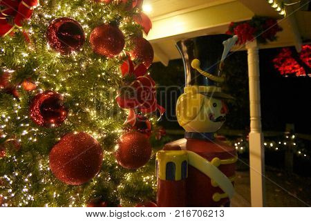 Christmas tree with red decorations and white lights