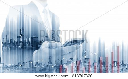 Double exposure Businessman using mobile smart phone with modern buildings. Business growth and investment