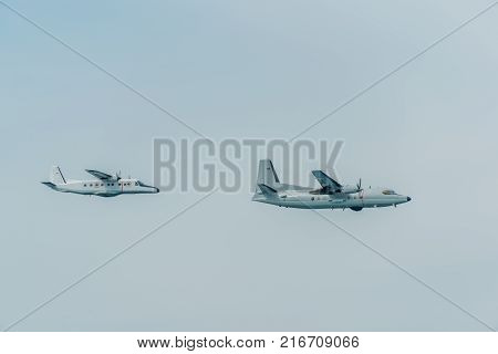 Two warplanes flying on misty blue sky in sunny day