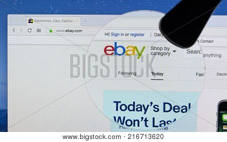 Sankt-Petersburg Russia December 4 2017: Homepage of eBay website on iMac monitor screen under magnifying glass. eBay is a multinational e-commerce corporation. Largest online auction and shopping websites.