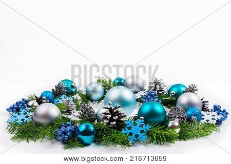 Christmas Wreath With Silver Ribbon And Purple Baubles, Copy Space.