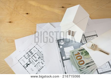 House remodel. The top view of a table of architects with the drawing of the house, with the paper model of the house, with a ruler and a pencil. Purchase of the real estate