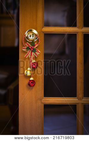 Christmas bells hanging on the door knob