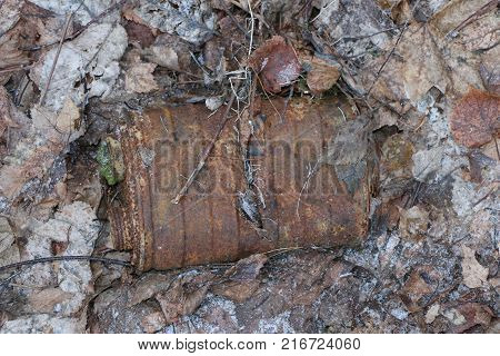 old rusty coal filter of Soviet gas mask RKKA era of the Second World War lies in the forest among the fallen leaves