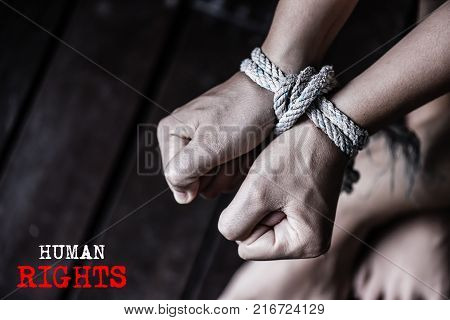 Closeup woman hands were tied with a rope. Violence Terrified Human Rights Day concept.