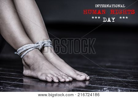 Closeup woman legs were tied with a rope. Violence Terrified Human Rights Day concept.