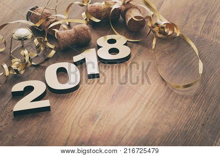 Happy New Year 2018. Symbol from number 2018 on wooden background.