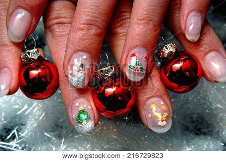 Close-up view on red colored x-mas fingernails