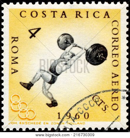 ROMANIA - CIRCA 1960: A stamp printed in the Romania shows weightlifting, Summer Olympics, Roma 60, circa 1960