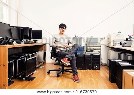system administrator with lots of hardware, computers and monitors