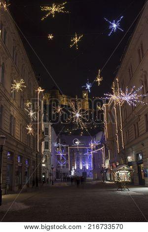 Ljubljana city center, historical core, triple bridge, Magistrat, castle, Presener square, church with colorful lights decoration during december holidays, winter, christmas tree. Slovenia, Europe