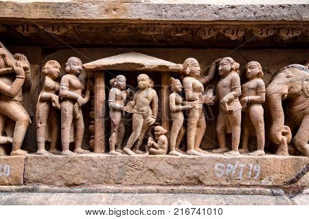 Famous genre bas relieves, Lakshmana Temple, Khajuraho, India. Unesco World Heritage Site. The most famous landmark in India. Temple of love. Kama Sutra