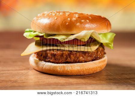 Fresh hamburger on wooden table - closeup shallow depth