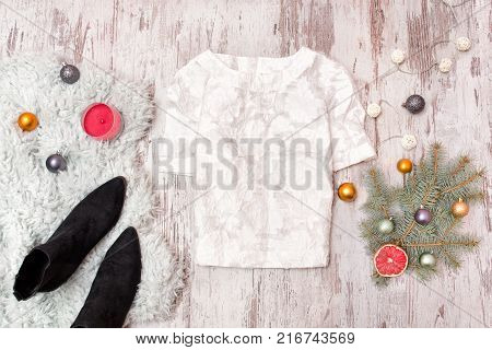 White Blouse, Shoes And  Decorated Fir Branch On Wooden Background. Fashionable Concept.