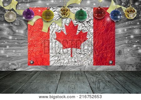 Christmas background with christmas ball and canada Flag on a old wooden background