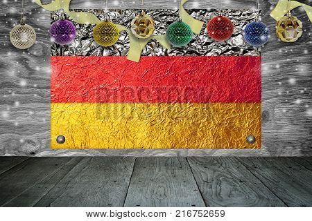 Christmas background with christmas ball and germany Flag on a old wooden background