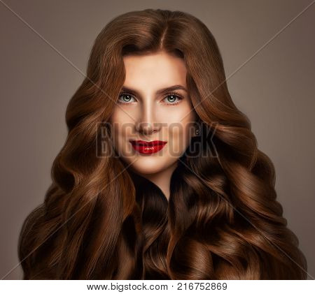 Redhead Woman Fashion Model with Long Red Wavy Hair. Perfect Hairstyle Haircare Concept