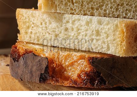fresh delicious slices of wheat bread. Bread on table. Bread for background.Bread from wheat