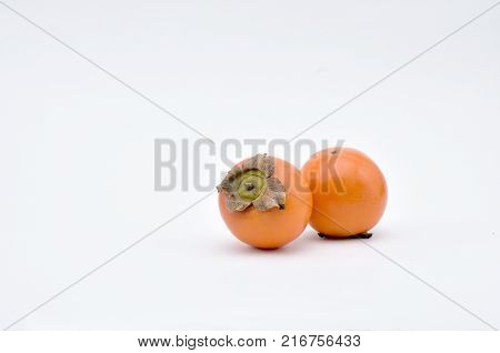Persimmonsouthern fruit of orange-red colorsweet and astringent to taste