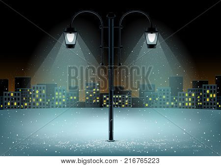 Electric pillar and falling snow in lamps lights. Christmas snowflakes falls on night city background