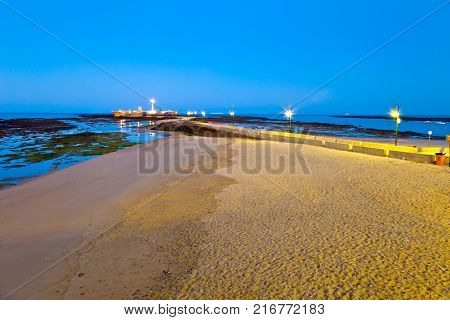 Landscape of the beach of La Caleta on the province of Cadiz on Spain about to dawn