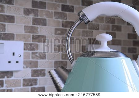 closeup of a Domestic kitchen electric kettle appliance with copy space