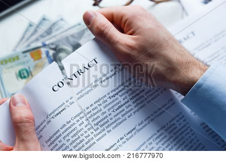 Disappointed or deceived businessman tears up a contract.