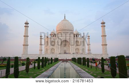 Agra India - Jul 13 2015. View of Taj Mahal at sunset in Agra India. The palace was commissioned in 1632 by Shah Jahan to house the tomb of his favourite wife.