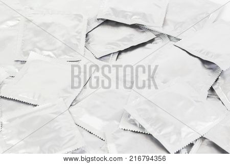 Background Of Condoms. Condoms On A White Background.