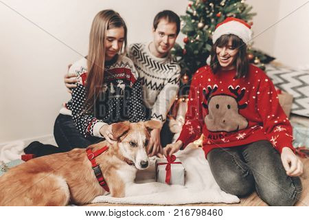 Merry Christmas And Happy New Year Concept. Stylish Hipster Family In Festive Sweaters Playing And S
