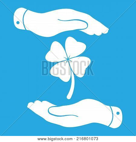 two hands protecting clover with four leaves sign icon. on a blue background. Saint Patrick symbol