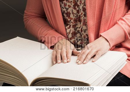 Books Braille. The touch of your fingertips the texture of the paper reading the sign. Reading the book blind man.
