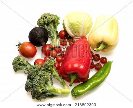 Bell Peppers With Cherry Tomatoes And Cabbages Isolated On White