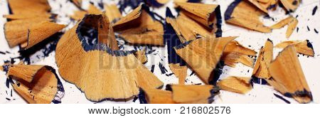 Pencil shavings on white background. Blue crayon shavings close-up.