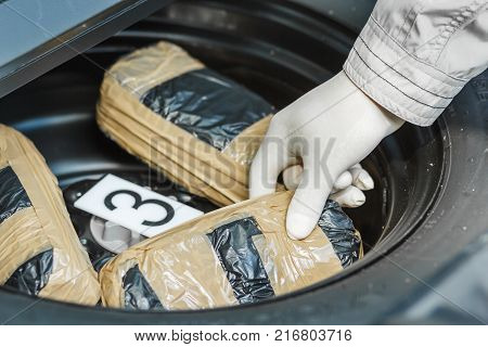 The Policeman Keeps A Package Of Drugs Found In The Car.